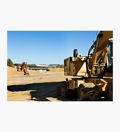Excavators in a road construction site Photographic Print