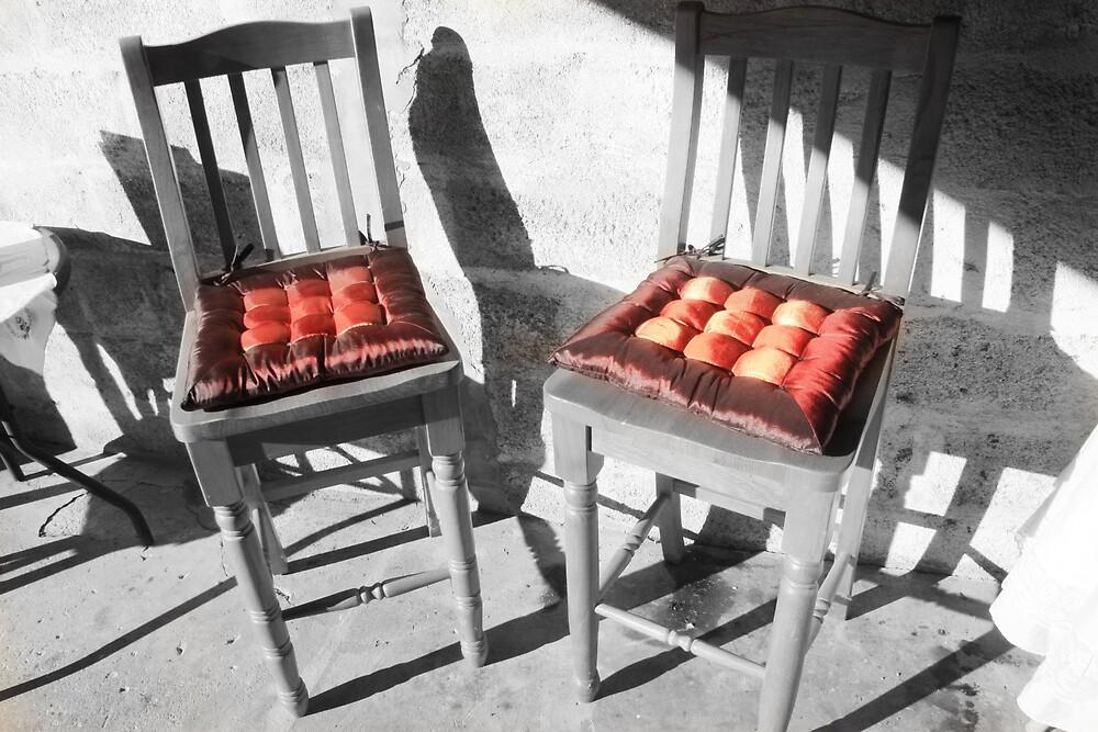 Stark chairs, colourful cushions by Stephen Denham