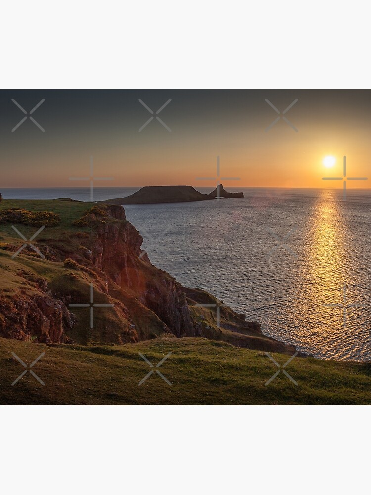 Sunset at Worms head rhossili bay by leightoncollins