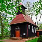 Picturesque wooden church in Poland by Elzbieta Fazel