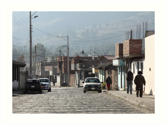 Daily life Guamote city street with people on sidewalk, brick buildings by Kendall Anderson