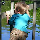 child watching ducks by raindancerwoman