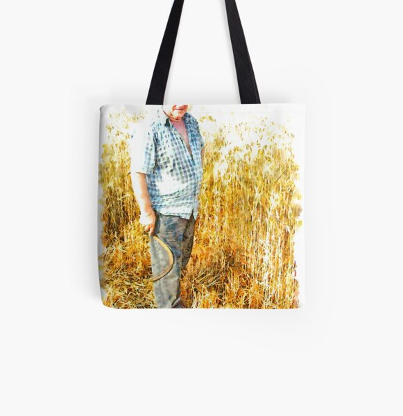 Farmer with sickle between the wheat All Over Print Tote Bag