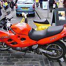 orange motorbike by armadillozenith