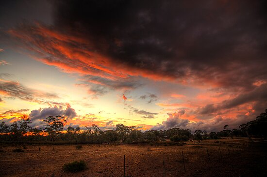 Stormy Sunset by Rikki  Pool