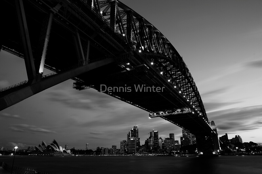 Opera sheltered by Harbour Bridge by Dennis Winter