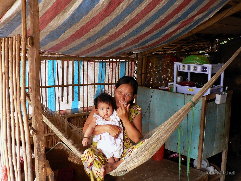 Mother and child, Mekong River, Vietnam by John Mitchell
