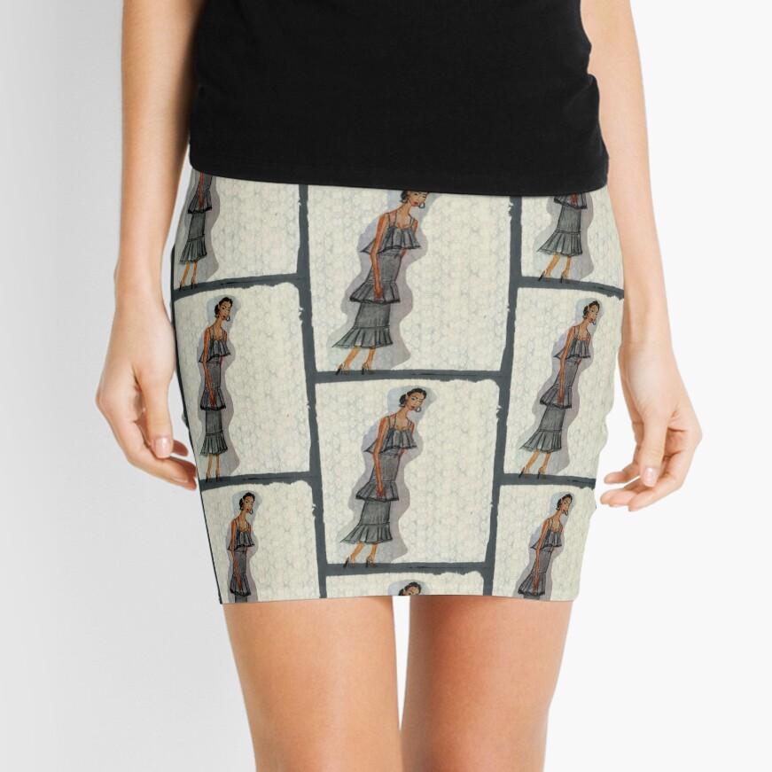 A Pretty Girl In a Ruffled Grey dress Mini Skirt