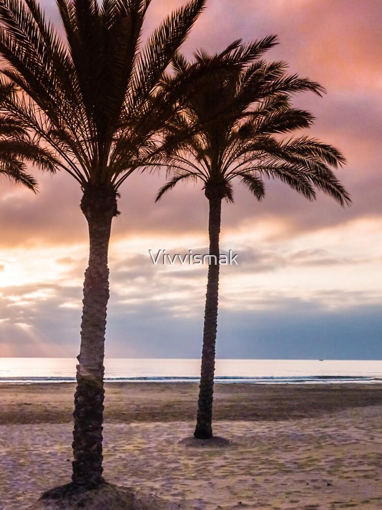 The Sun Rising Between Three Palm Trees on The Beach by Vivvismak