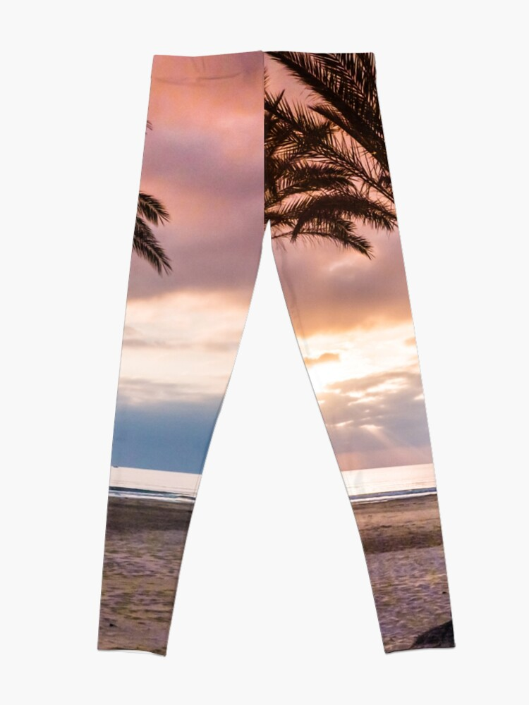 Alternate view of The Sun Rising Between Three Palm Trees on The Beach Leggings