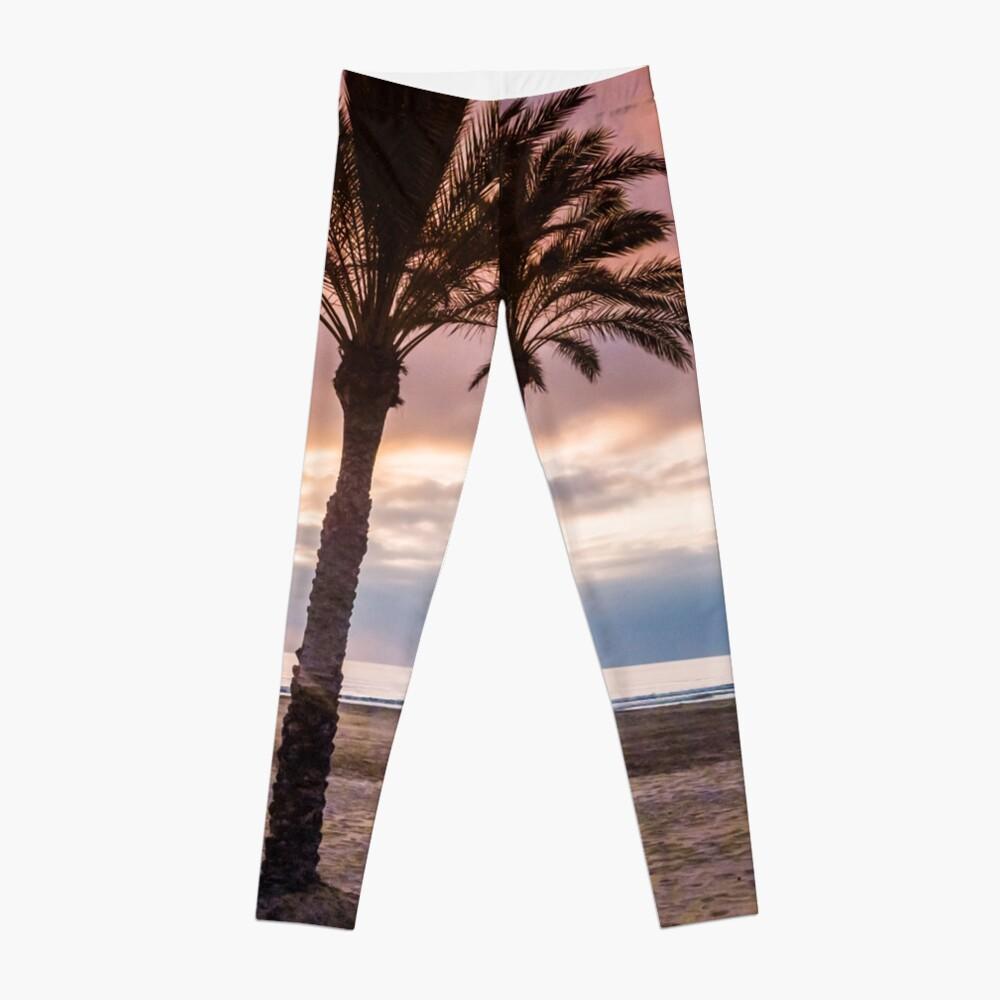 The Sun Rising Between Three Palm Trees on The Beach Leggings