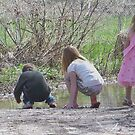 mud puddles and kid go together by conilouz