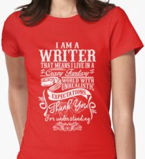 I AM A WRITER, THAT MEANS I LIVE IN A CRAZY FANTACY. THE WORLD WITH UNREALISTIC EXPECTATIONS , THANK YOU. Womens Fitted T-Shirt