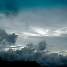 Blue clouds collide by KimOZ