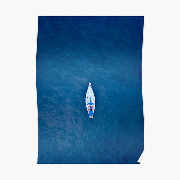 A drone shot of a sailing boat surrounded by deep blue sea water | Aerial Print Poster