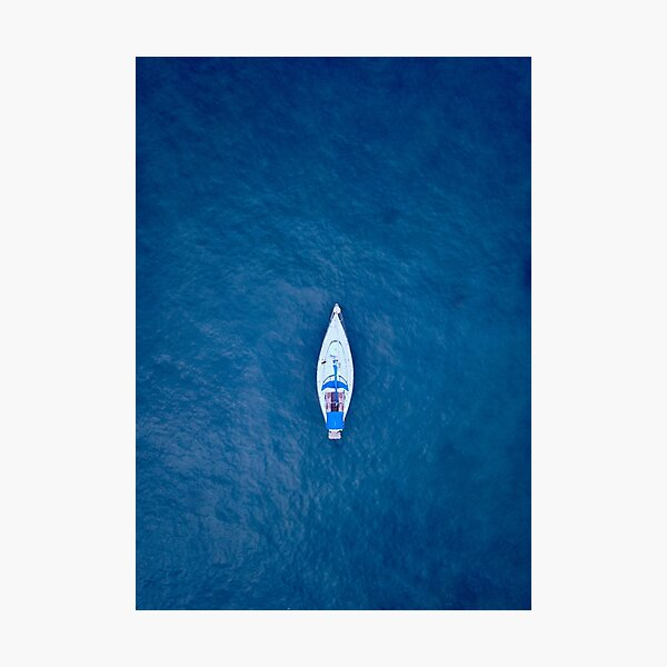 A drone shot of a sailing boat surrounded by deep blue sea water | Aerial Print Photographic Print