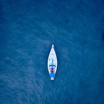A drone shot of a sailing boat surrounded by deep blue sea water by The-Drone-Man