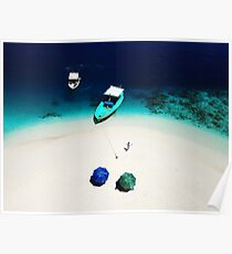 A drone shot of a lady walking on the beach and two boats moored next to a sand bank island in Maldives Poster