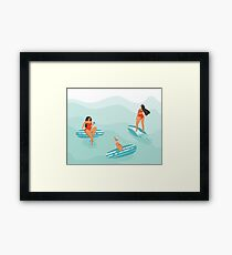 Surfing girls Framed Print