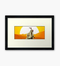 Lawrence of Arabia - Sunset on the desert with a man holding a gun Framed Print