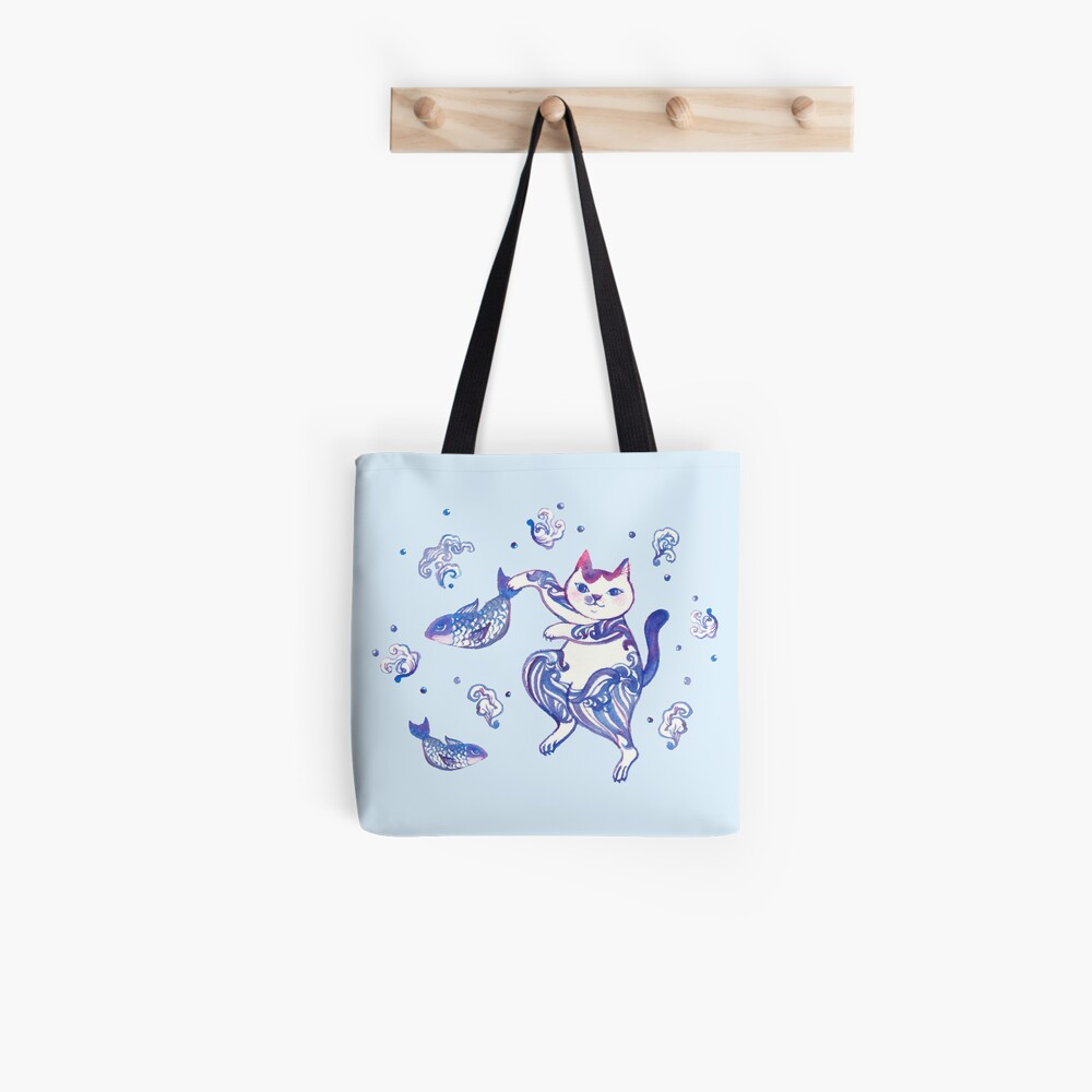 A cat catching fishes Tote Bag