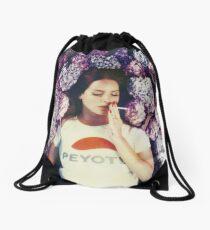 Lana Laying in Flowers Drawstring Bag