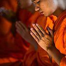 Monk Praying in Temple - Bangkok, Thailand by Yen Baet