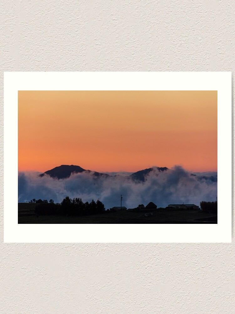 Alternate view of Orange sunset with mountain silhouette in clouds, Gulahuayco, Ecuador Art Print