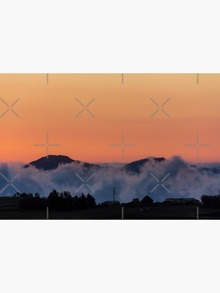 Orange sunset with mountain silhouette in clouds, Gulahuayco, Ecuador by kpander