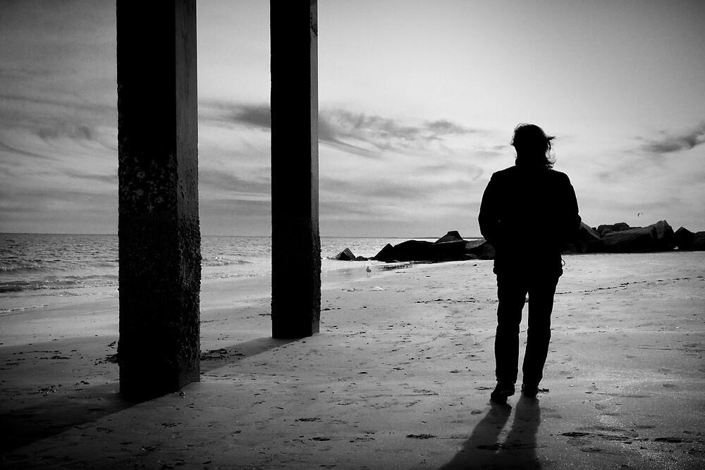 Stroll on the beach by Carlos Restrepo