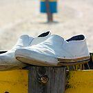 Shoes on a bin by Rukshan Fernando
