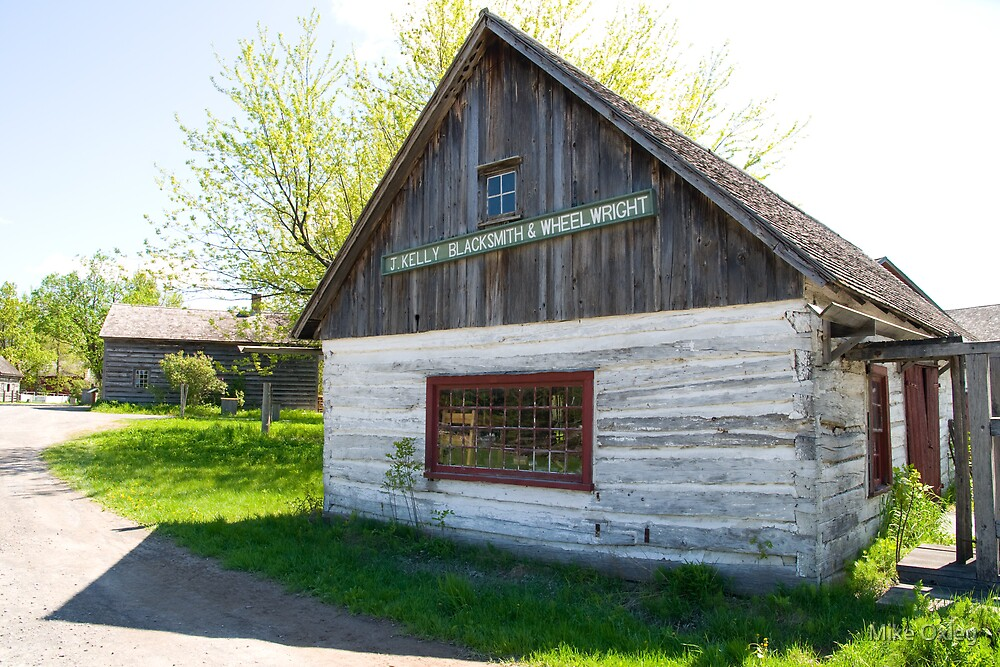 J. Kelly Blacksmith and Wheelwright, Upper Canada Village, Ontario, Canada by Mike Oxley