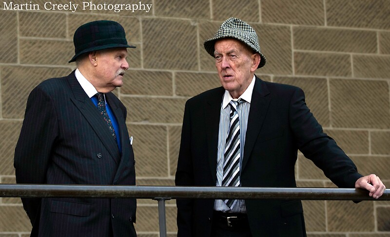 Men with hats by Martin Creely