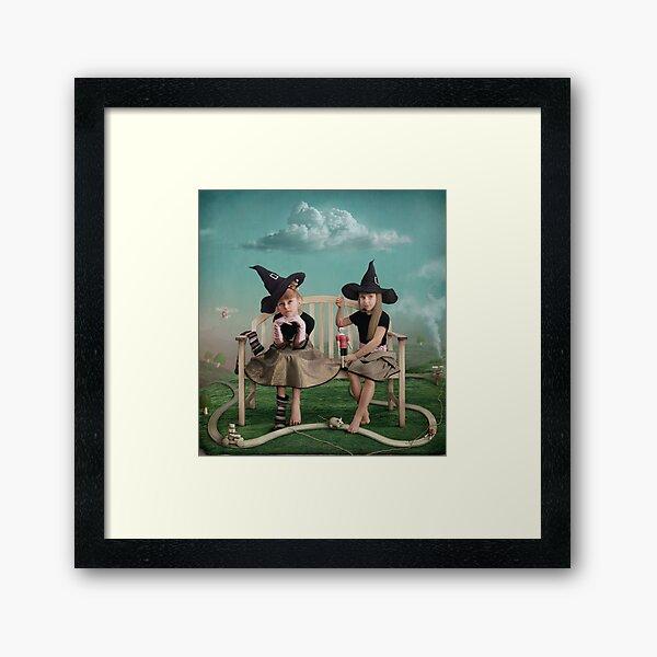 Young sorceress Framed Art Print