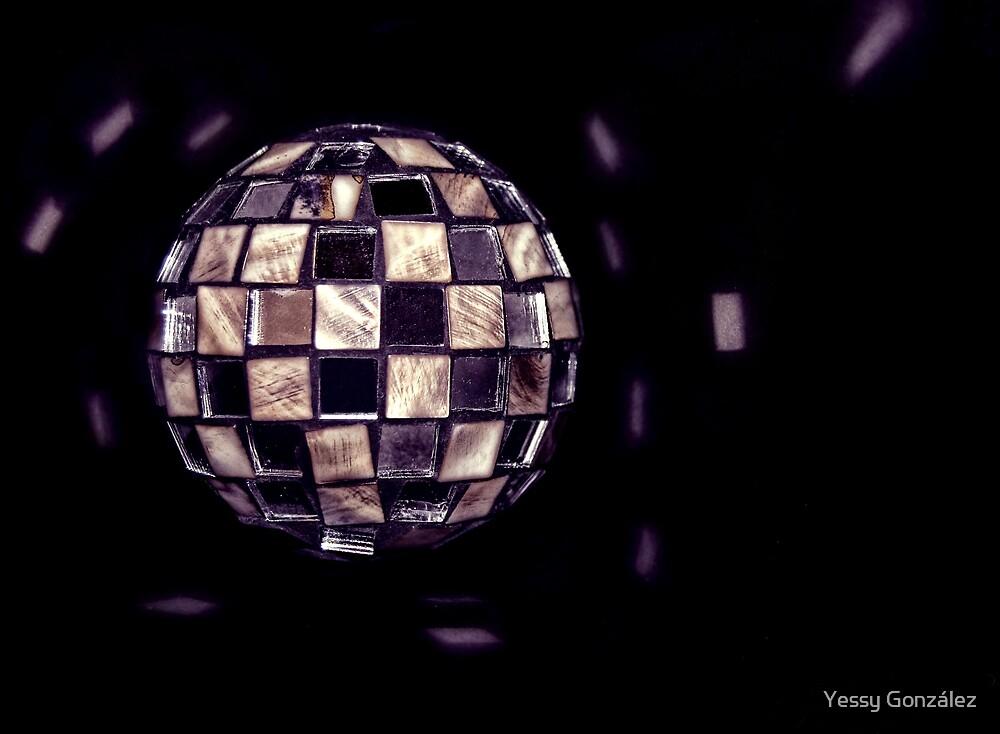 Crystal ball by Yessy González