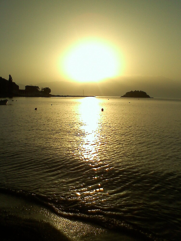 The evening sun on a beautiful beach, by Christina Parapadakis
