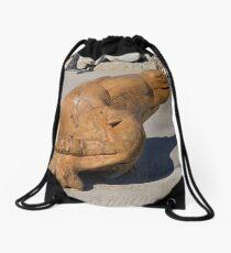 A strange seat Drawstring Bag