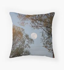 Moon while sunsets Throw Pillow