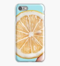 Juicy lemon on a blue background iPhone Case/Skin