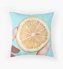 Juicy lemon on a blue background Throw Pillow