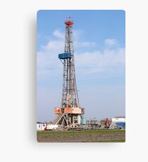 land oil drilling rig with equipment on oilfield Canvas Print