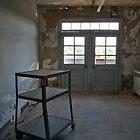 Wheeling shelf in an abandoned hospital by DariaGrippo