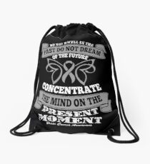 Do Not dwell in the past do not dream of the future, concentrate the mind on the present moment. Brain Cancer Awareness Quote  Drawstring Bag
