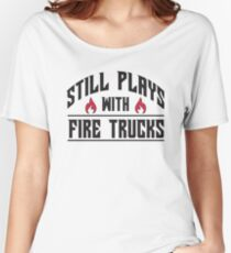 Still plays with fire trucks Women's Relaxed Fit T-Shirt