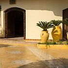 Cyber Yellow Mediterranean Courtyard with Amphoras and Palms by Georgia Mizuleva