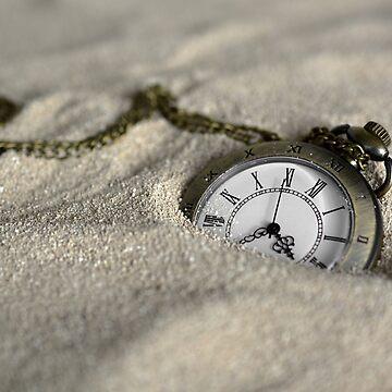 pocket watch in sand by harrizon