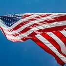 American Flag Blowing in the Wind by PixLifePhoto