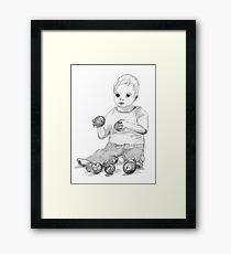 Boy with apples Framed Print