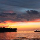 Silhouette of people fishing on a boat in the Florida Keys by Adam Nixon