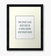 A Fake Smile and Dead Eyes Framed Print